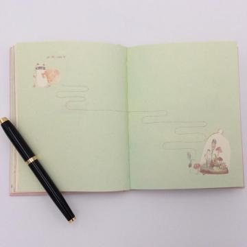 Paper notebook with cute graph