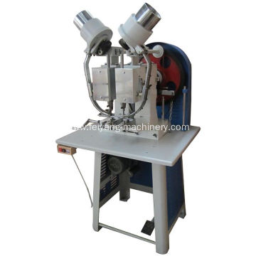 auto double head eyelet machine