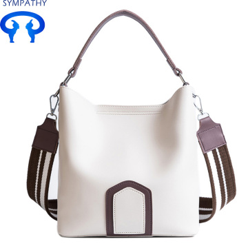 Impact color handbag with a wide shoulder strap