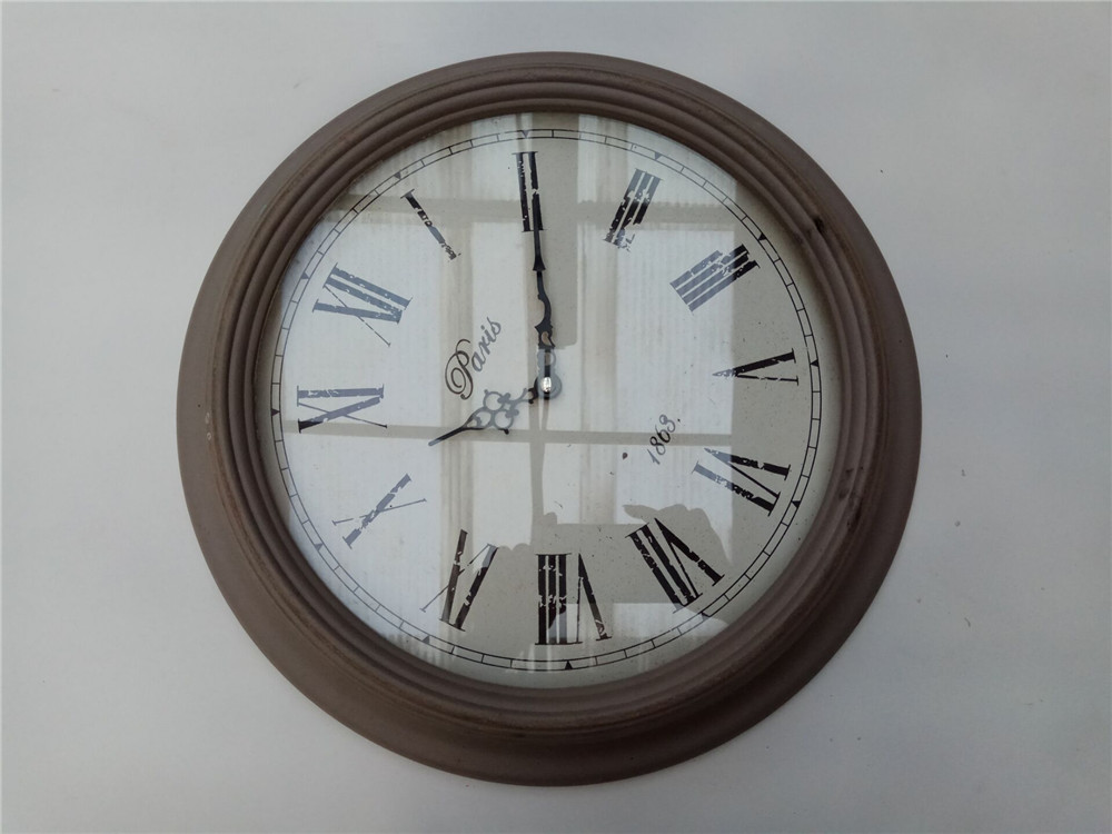 big outstand wooden clock hanging