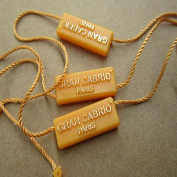 Cardstock tags with string for garment furniture